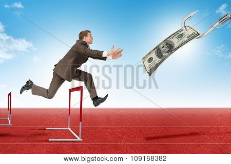 Man hopping over treadmill barrier with dollar