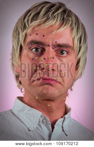 Bacteria virus sickness on blonde haired man's face