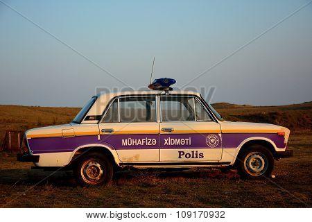 Old Lada police car in Azerbaijan in a rural setting