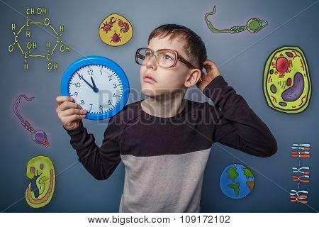 Teenage boy in glasses holding a clock hand and scratching his h