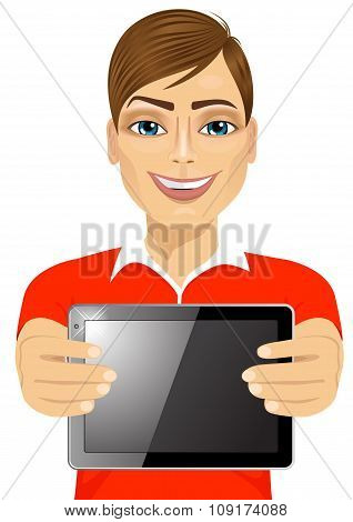 young teenager boy displaying tablet