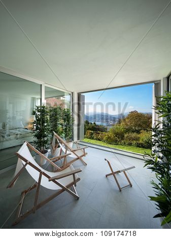 Interior of a modern house,�balcony overlooking the lake