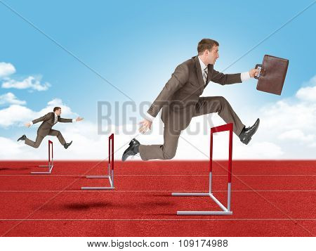 Man hopping over red treadmill barrier