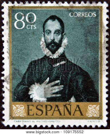 SPAIN - CIRCA 1961: A stamp printed in Spain shows Nobleman with his Hand on his Chest by Greco