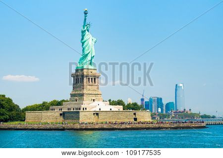 The Statue of Liberty in New York City with Ellis Island on the background