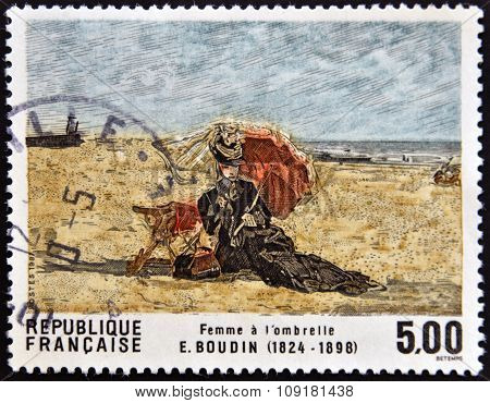 FRANCE - CIRCA 1987: A stamp printed in France shows Woman with umbrella by Boudin circa 1987