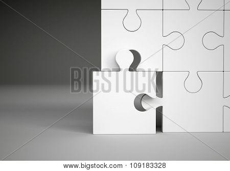 Puzzle pieces on grey