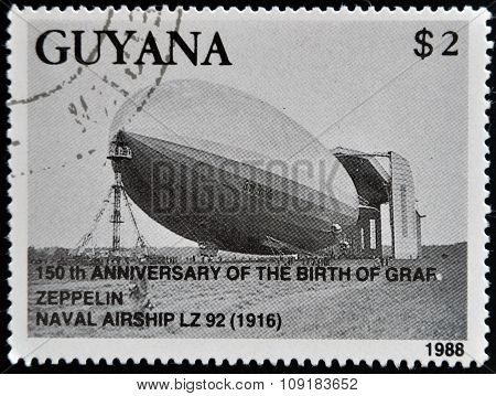 A stamp printed in Guyana shows 150th anniversary of the birth of zeppelin The Graf Zeppelin Naval