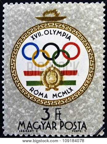 A stamp printed in Hungary shows emblem devoted to the Olympic games in Rome