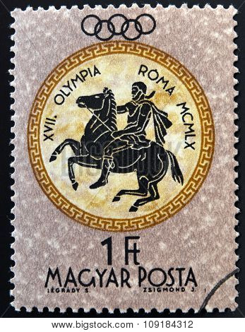 A stamp printed in Hungary shows equestrian devoted to the Olympic games in Rome