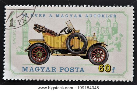 HUNGARY - CIRCA 1975: A stamp printed in Hungary shows retro car circa 1975