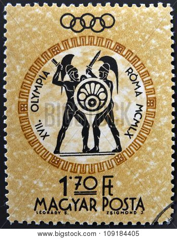 A stamp printed in Hungary shows gladiators devoted to the Olympic games in Rome