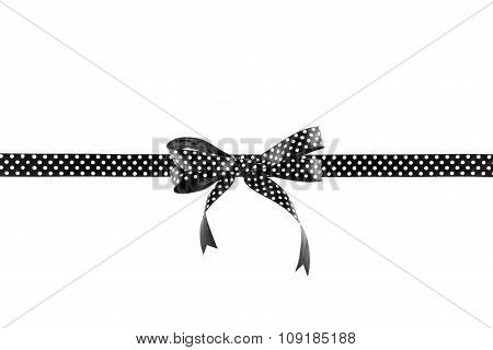 Black and white ribbon with a bow on a white background