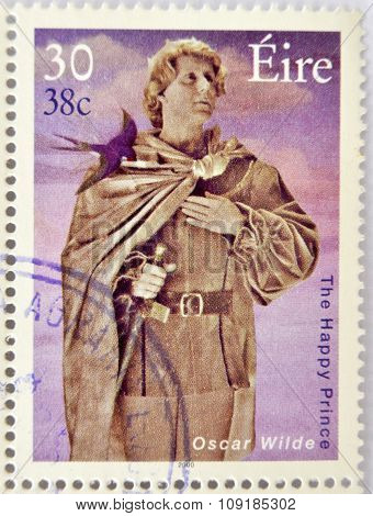 a stamp printed in Ireland shows an image commemorative of The happy prince a book by Oscar Wilde