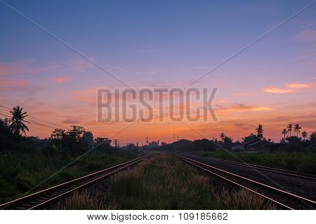Railway Tracks In A Rural Scene With Nice Sunrise