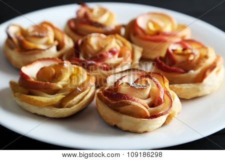 Fresh Puff Pastry With Apple Shaped Roses On Black Wooden Table