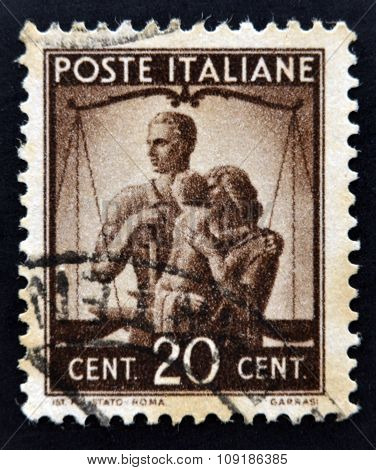 ITALY - CIRCA 1945: A stamp printed in Italy shows Work Justice and Family circa 1945