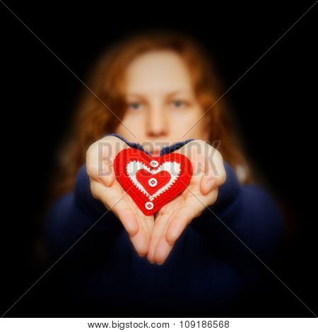 Young Girl Holds In Hands Red Heart