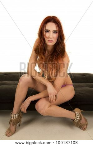 Woman Red Hair Bikini Sit On Black Bench Arms Crossed