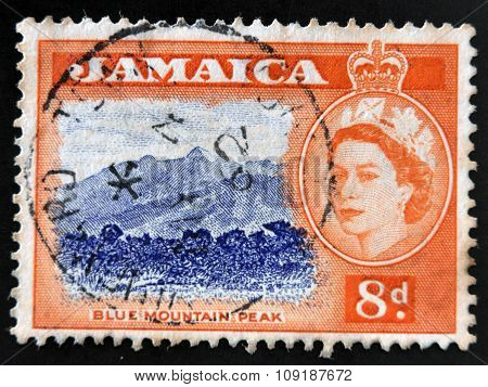 JAMAICA - CIRCA 1962: A stamp printed in Jamaica shows blue mountain peak circa 1962
