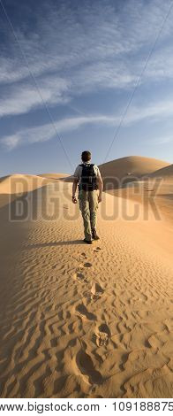 Man in a desert sand dune