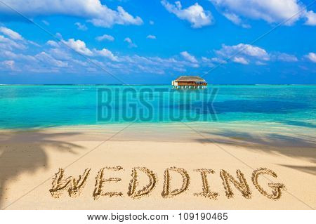 Word Wedding on beach - concept holiday background