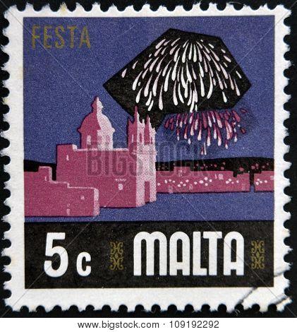 MALTA - CIRCA 1973: A stamp printed in Malta shows fireworks over the harbor of Valletta circa 1973