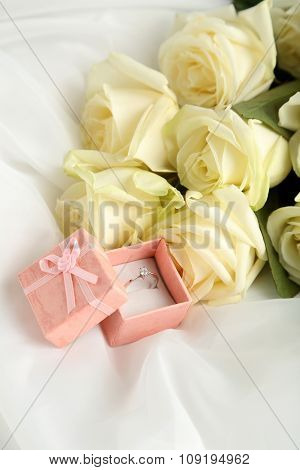 Bouquet Of White Roses On White Fatin