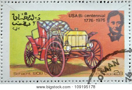 OMAN - CIRCA 1976: A stamp printed in State of Oman shows a american car schacht 1908 usa circa 1976