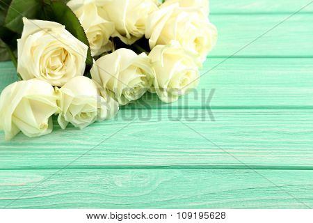 Bouquet Of White Roses On Mint Wooden Background