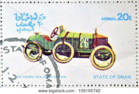 OMAN - CIRCA 1977: A stamp printed in State of Oman shows a old car Calthorpe 1912 Great Britain