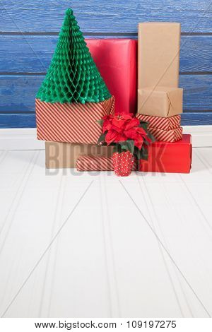 Christmas red gifts stacked at the floor
