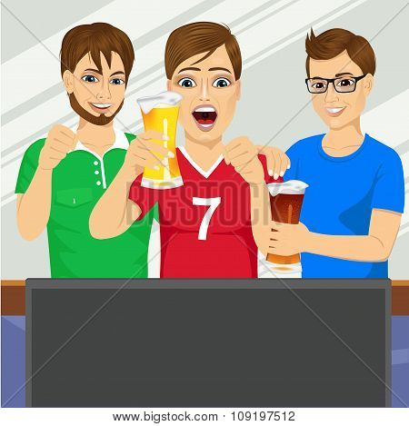 three young friends watching sports game