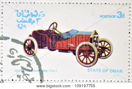 OMAN - CIRCA 1977: A stamp printed in State of Oman shows a old car Isotta Fraschini 1908 Italy