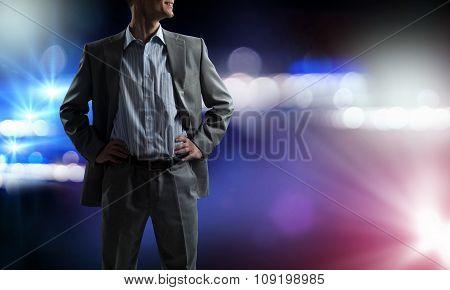 Confident businessman in bokeh lights