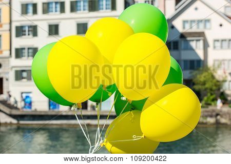 Bright Yellow And Green Balloons On A City Street