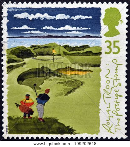 A stamp printed in Great Britain shows Golfers with inscriptions
