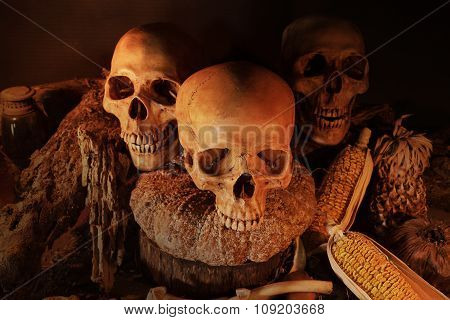 Still Life With Three Skulls And Dry Fruit