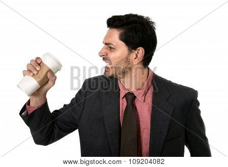 Stressed Businessman In Suit And Tie Crushing Empty Cup Of Take Away Coffee In Caffeine Addiction Co