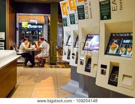 PARIS, FRANCE - AUGUST 10, 2015: McDonald's restaurant interior. McDonald's is the world's largest chain of hamburger fast food restaurants, founded in the United States.