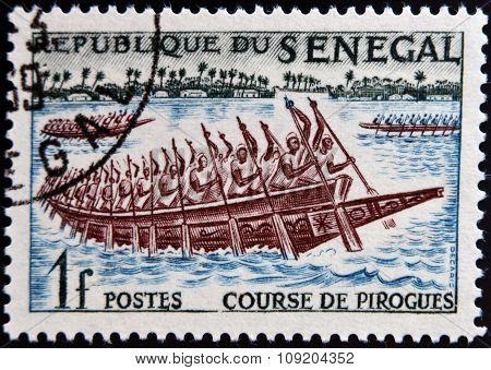 SENEGAL - CIRCA 1961: a stamp printed in Senegal shows Pirogues Racing circa 1961