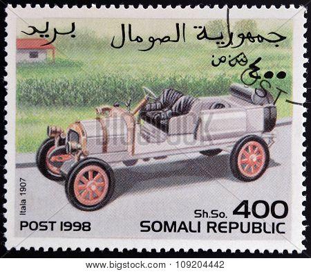 SOMALIA - CIRCA 1998: stamp printed in Somali republic shows retro car Itala 1907 circa 1998.