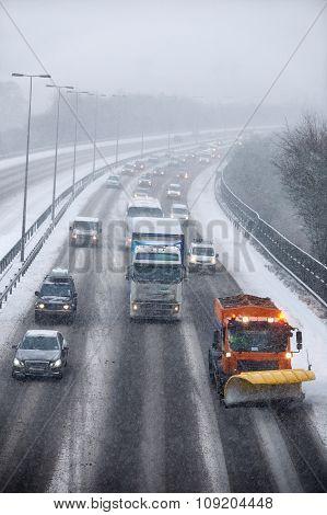 Snowplough Clearing Motorway During Winter
