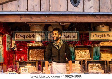 The Nougat Seller Of Christmas Market In Paris.