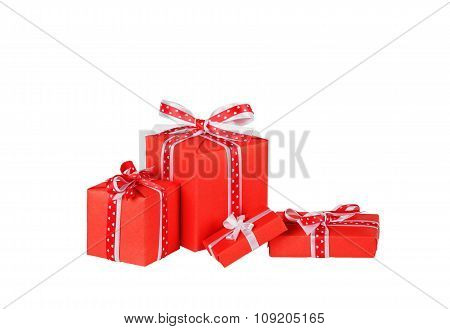 red gift boxes with ribbon bows