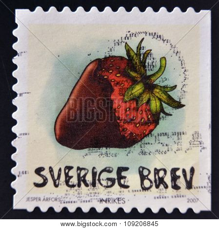 SWEDEN - CIRCA 2007: stamp printed in Sweden shows Chocolate-dipped strawberry circa 2007