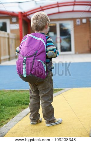 Child Going To School Wearing Backpack