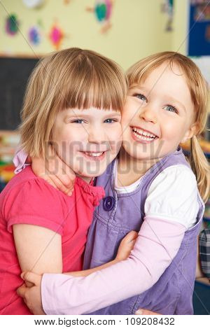 Two Girls Hugging At Pre School