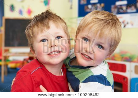 Two Boys Hugging One Another At Pre School