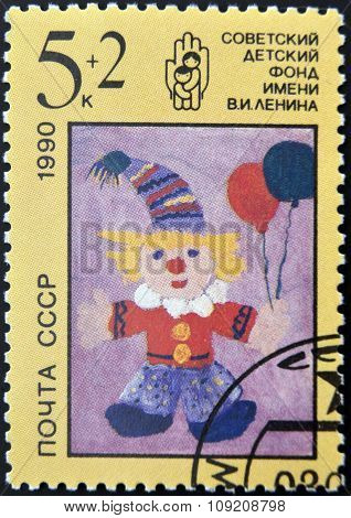 USSR - CIRCA 1990: A stamp printed in the USSR shows children's draw Red-haired clown with two balls